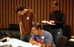 Scoring intern Aaron Moore, composer Christopher Lennertz and orchestrator Andrew Kinney