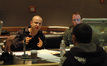 Theodore Shapiro talks with Chris Fogel as Bryan Carrigan watches