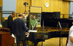 During a break John Ottman, Jeffrey Schindler and Rick Giovinazzo try out a couple ideas on the piano