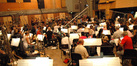 Alan Silvestri gives notes to the orchestra