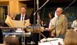 Brian Tyler examines the score with orchestrator Brad Warnaar