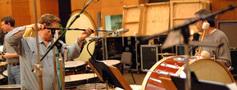 Tom Kidd sets up a microphone