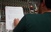 Austin Wintory reads through a cue while it's performed overseas at Abbey Road Studio 2.