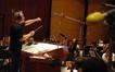 John Debney conducts