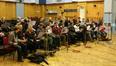 The choir gets prepared for their first cue...