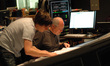 Orchestrator Abe Libbos talks with scoring mixer Dennis Sands