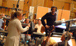 Director Anne Fletcher talks with the orchestra as Aaron Zigman looks on
