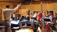 Marshall Bowen conducts the choir