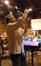 Scoring mixer Bobby Fernandez sets up a microphone
