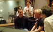 Brian Robbins congratulates John Debney on an amazing cue as concertmaster Belinda Broughton applauds