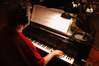 Mike Lang performs the piano