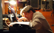 Christopher Young reworks a cue at the piano
