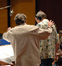 Christopher Young gives feedback to conductor Bruce Babcock