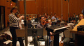Concertmaster Belinda Broughton gives feedback to the strings