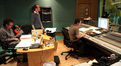 Composer Garry Schyman, orchestrator/score supervisor Peter Bateman, and score mixer Dan Blessinger listen to playback
