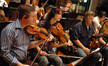 Concertmaster Mark Robertson and the string section