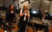 Composer Deborah Lurie and orchestra contractor Sandra Kipp thank the orchestra