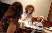 Deborah Lurie talks with music editor Nancy Allen and director Lasse Hallstrom