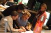 Arranger Tom Gire, composer Heitor Pereira, arranger John Sponsler and scoring mixer Slamm Andrews examine a cue