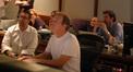 Chris Lennertz, Jeff Vaughn, and director Tom Dey listen to playback