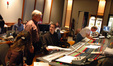 Orchestrator Dana Niu, contractor David Low, and orchestrator Andrew Kinney discuss a cue
