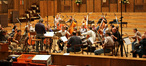 The orchestra is getting ready to record