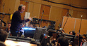 John Debney conducts the orchestra