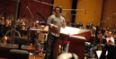 Composer Christopher Lennertz looks to the booth for feedback