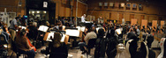 Nick Glennie-Smith conducts the orchestra at Sony