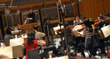 Fil Eisler conducts the orchestra at Capitol Studios