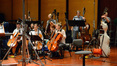 The cellos and basses wait for the next cue