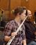 A flutist keeps her instrument warm