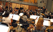 The orchestra records with composer and conductor Fil Eisler