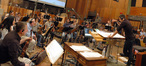 The violins listen to feedback from composer and conductor Fil Eisler