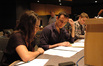 Intern Brittany DuBay, assistant Todd Park and intern Josh Ellis listen to a cue
