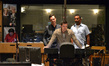 Actor Nick Wechsler talks to the orchestra with composer Fil Eisler and show-runner Sunil Nayar
