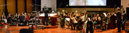 Composer and conductor Fil Eisler at the podium with the orchestra on the Eastwood Scoring Stage at Warner Bros.