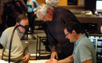 Music librarian Marshall Bowen, orchestrator/conductor Tim Simonec and composer Michael Giacchino go over a cue
