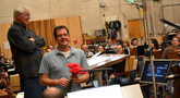 Michael Giacchino gives flowers to the mothers in the orchestra on Mother's Day