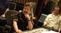 Scoring mixer Scott Cochran ponders while Aaron _____ listens