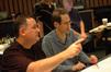 John Dennis and Randy Miller discuss a cue
