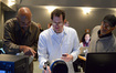 Music librarian Booker White, composer Michael Giacchino, and orchestra contractor Reggie Wilson review a cue