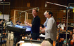 Director Andrew Stanton speaks with the orchestra accompanied by conductor/orchestrator Tim Simonec and composer Michael Giacchino