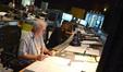 Orchestrator Brad Dechter and composer Mervyn Warren listen to a cue