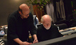 Arranger Randy Kerber looks over the music with John Williams