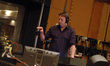 Orchestrator Stephen Coleman conducts <i>Red Dawn</i>
