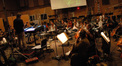 Stephen Coleman conducts the strings in <i>Red Dawn</i>