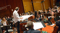 Composer/conductor Laurent Eyquem and the orchestra prepare to record