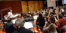 Composer/conductor Laurent Eyquem gives notes to the cello section between takes