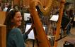 Harpist Marsha Dickstein enjoys a free moment